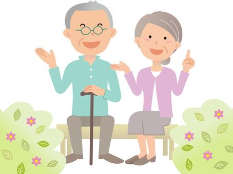 70225. Senior couple, bench, flower 2
