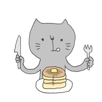 パンケーキ食べるネコ