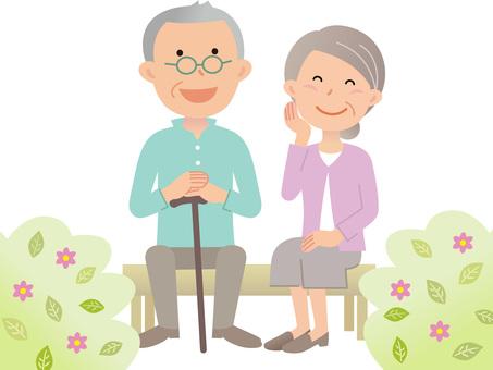 60711. Senior couple, bench, flowers