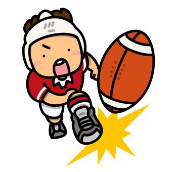 ラグビーボールをキックする男の子