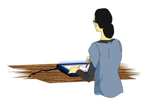 A woman tracing an illustration on the tracing table