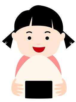 Smiling girl with onigiri