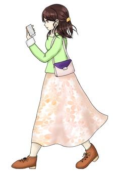 Walking smartphone woman