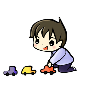 Boy playing with a car