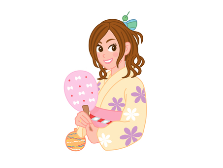 A girl in a yukata smiling