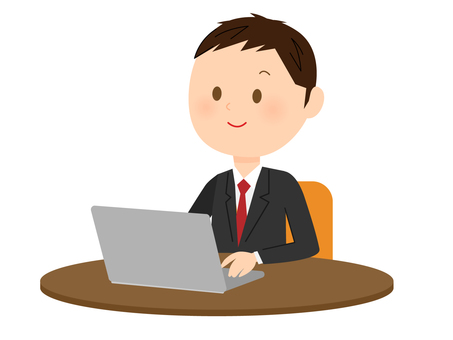 Man in suit using laptop
