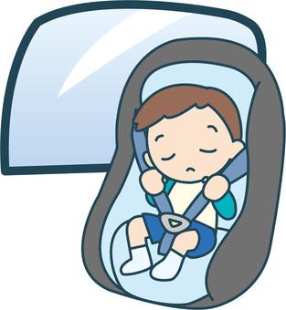 Boy sleeping on child seat