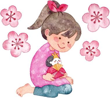 A girl holding a hina doll