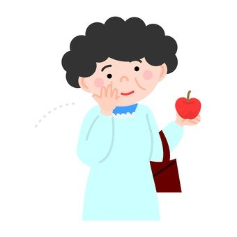A woman looking at an apple