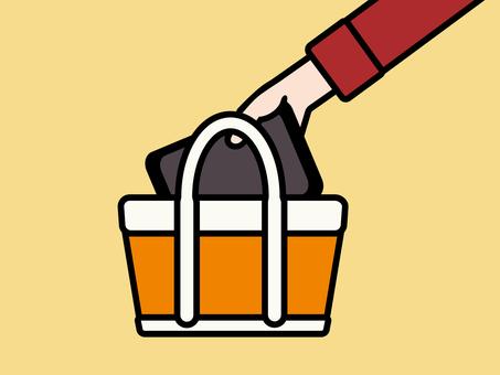 タブレットをバッグから取り出す オレンジ