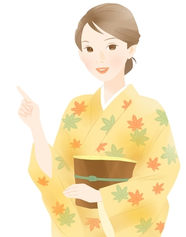 Women in Japanese clothing (pointing)