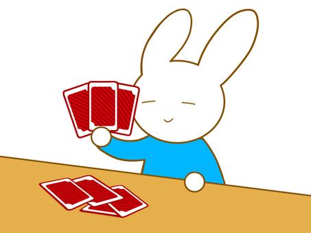 カードを持つウサギ
