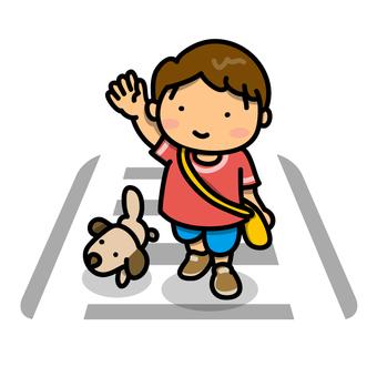 A boy crossing a pedestrian crossing
