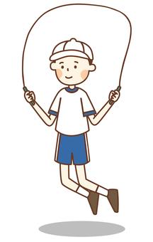 縄跳びをする体操着の男の子
