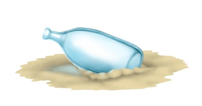 Bottle falling on sandy beach