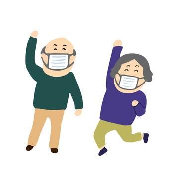 Cheerful elderly people in masks