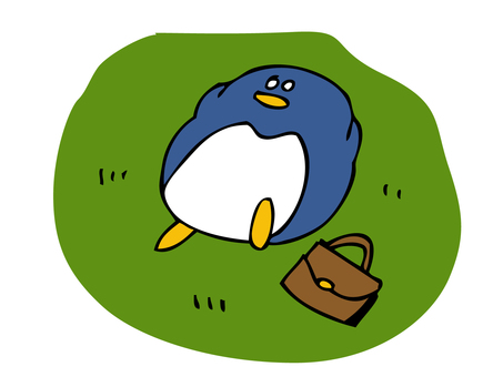 Penguin lying on the lawn