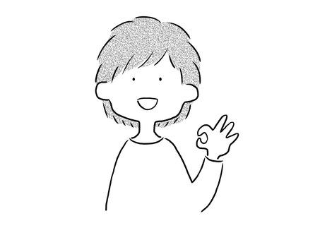 A boy giving an OK sign