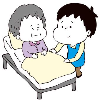 ベッド介助をする介護士男