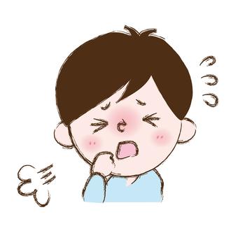 咳をする男の子