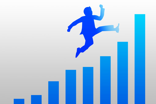 A businessman who jumps over with a jump