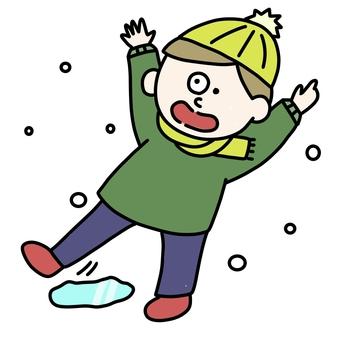 A boy sliding on a road link