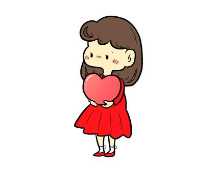一個女人抱著一顆心