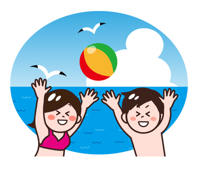 Male female playing with beach ball at sea