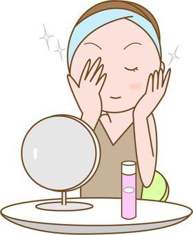 基礎化粧・肌の手入れをする女性