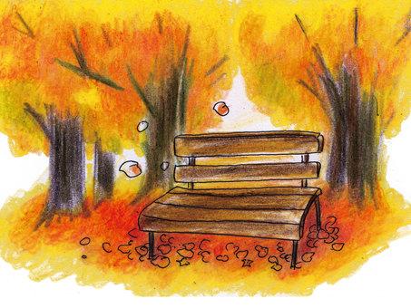 秋天的落葉和長凳