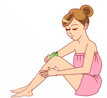 A woman applying lotion to her feet