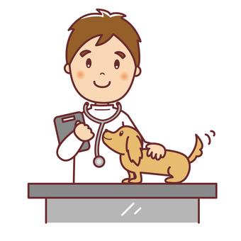 男性獣医さんと犬