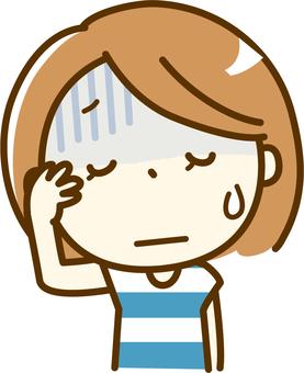 Baş ağrısı olan bir kadın