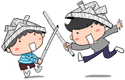 こどもの日に新聞紙の兜と剣で遊ぶ男の子