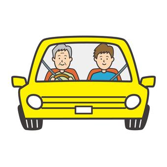 車に乗る父と息子