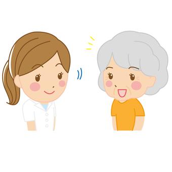 相談中のスタッフと高齢者