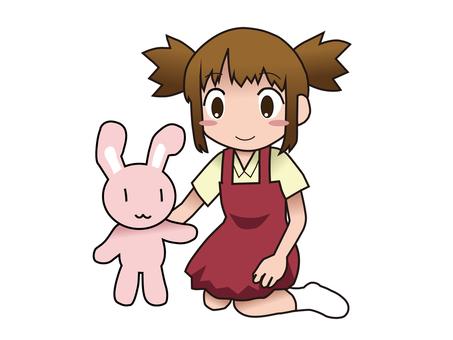 ウサギのぬいぐるみで遊ぶ女の子