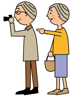 Senior couple holding a camera