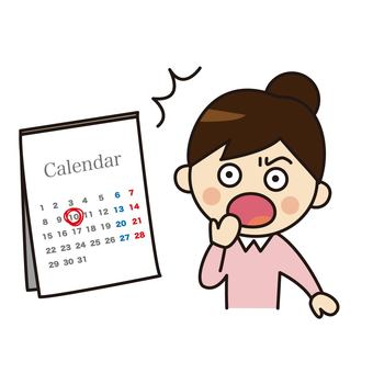 Surprised woman looking at a calendar