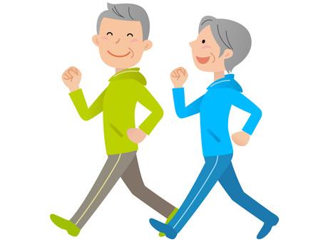 51101. Senior man and woman walking