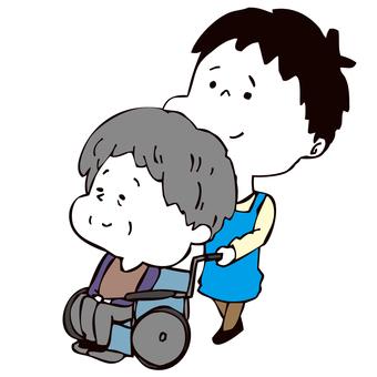 車いすを押す介護士男