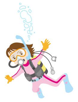 スキューバダイビングする女性