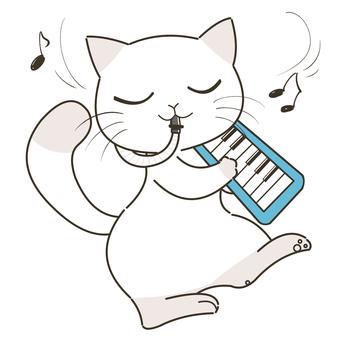 鍵盤ハーモニカを吹く猫