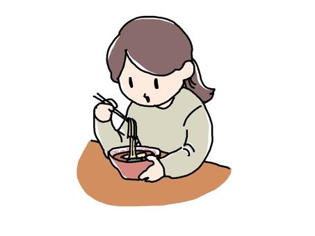 Woman eating ramen
