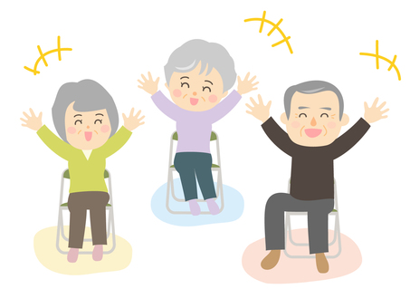 Three elderly men and women who laugh while sitting and doing yoga