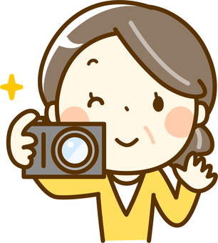 Senior woman holding a camera