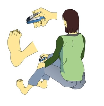 A woman cutting a nail of a foot