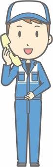 Mechanic male a - phone - whole body