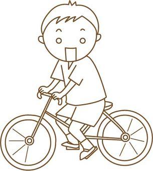一個騎自行車的男孩