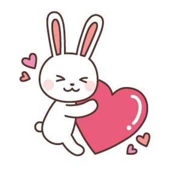 A rabbit holding a heart